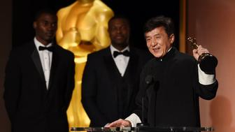 Actor Jackie Chan accepts his award on stage during the 8th Annual Governors Awards hosted by the Academy of Motion Picture Arts and Sciences at the Hollywood & Highland Center in Hollywood, California on November 12, 2016. / AFP / Robyn Beck        (Photo credit should read ROBYN BECK/AFP/Getty Images)