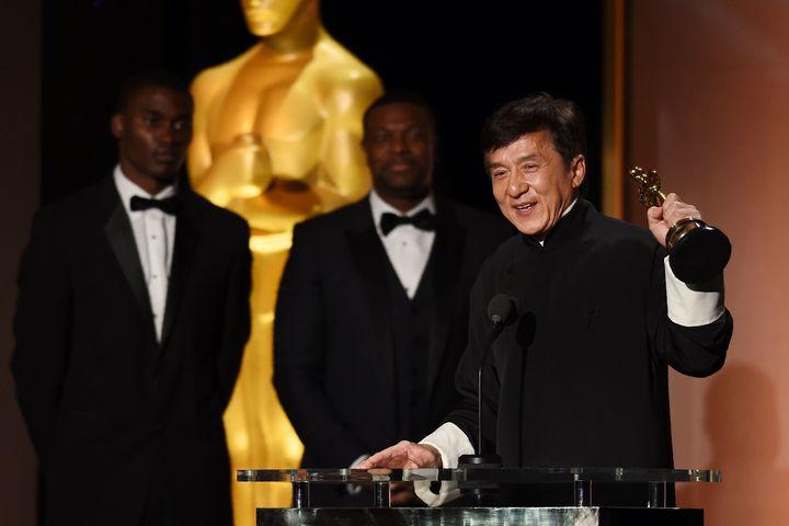 Jackie Chan, accepting the honoraryOscar.