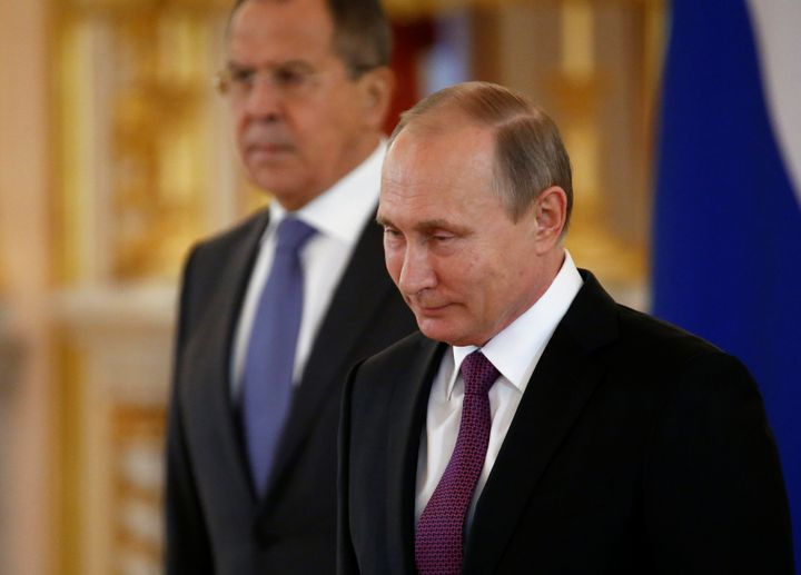 Russia's President Vladimir Putin and Foreign Minister Sergei Lavrov. On Wednesday, Russia announced it would withdraw from t