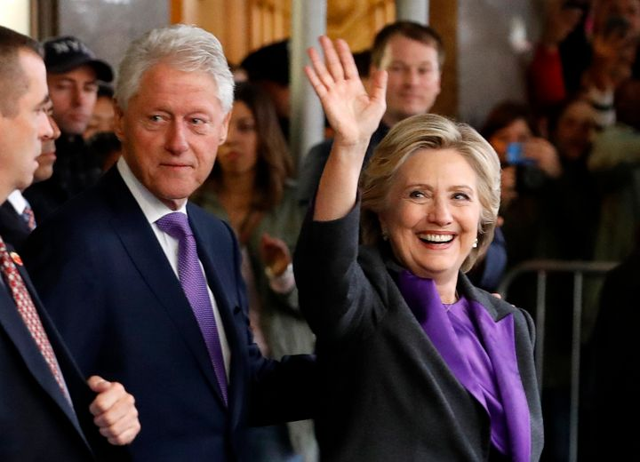 Hillary Clinton departs with her husband, former U.S. President Bill Clinton, after addressing her staff and supporters about