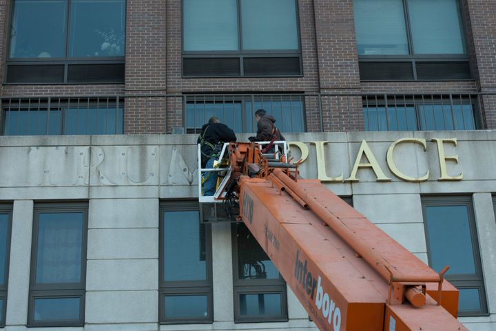 Workers remove Trump signage from 180 Riverside Blvd. on Manhattan's Upper West Side.