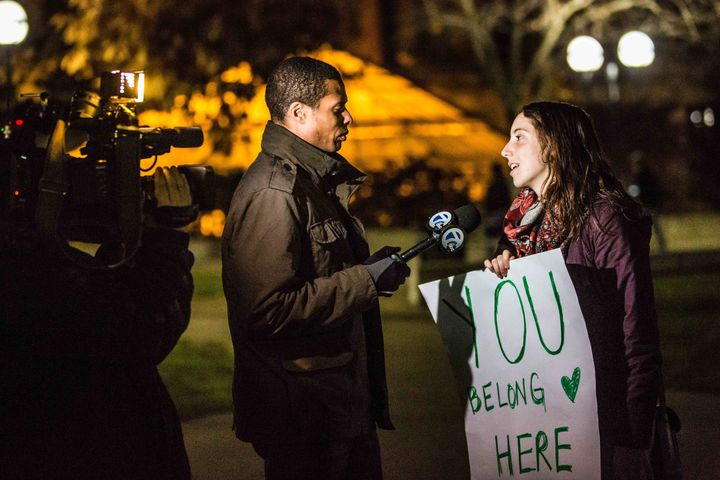 A supporter talks to the media during a solidarity event organized by Muslims at the University of Michigan.