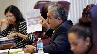 State Board of Education member Ruben Cortez Jr., center, questions a speaker during a hearing, Tuesday, April 8, 2014, in Austin, Texas. The Texas Board of Education is considering a proposal to add a Mexican-American studies course as a statewide high school elective. (AP Photo/Eric Gay)