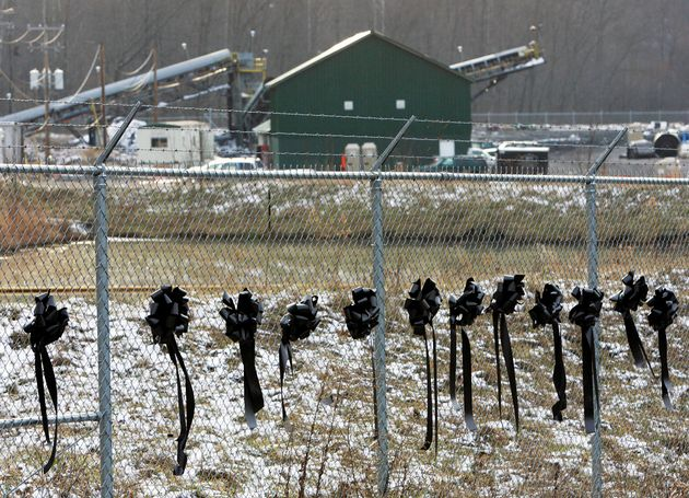 Twelve ribbons line a fence in front of the Sago Mine in Sago, West Virginia, in