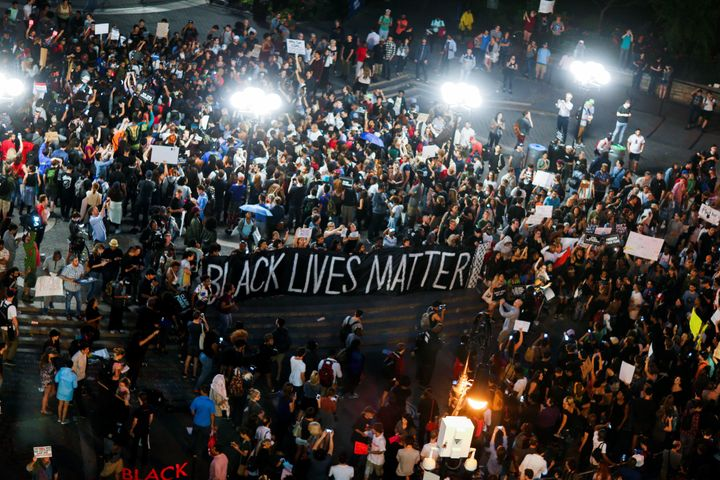 People take part in a protest against police brutality and in support of Black Lives Matter during a march in New York July 9
