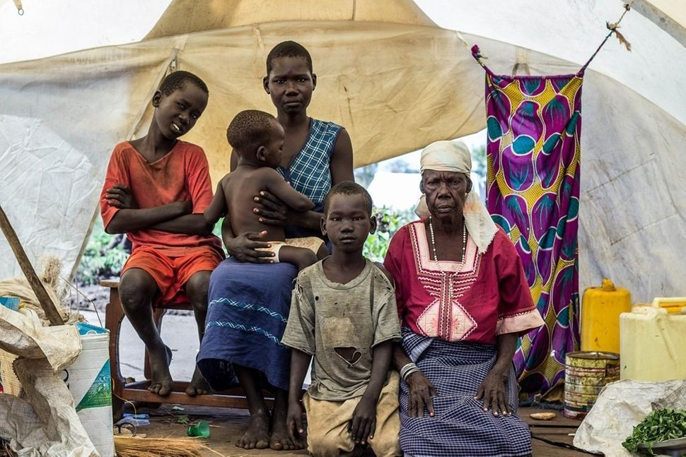"""At 60 years old, Mary F. lives in Pagirinya refugee settlement with her son, two daughters and two grandchildren. """"The soldie"""