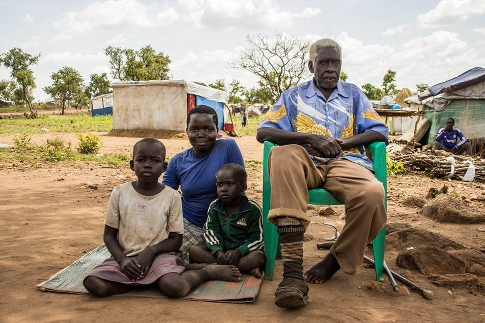 """""""Before the war, life was good in our country,"""" saidSimon O., who is 75 years old and lives in Pagirinya refugee settle"""