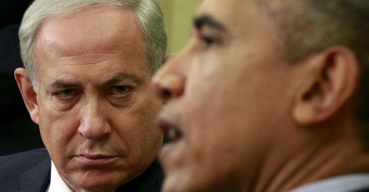 Netanyahu listens toObama during ameeting atthe White House on Nov. 9, 2015.