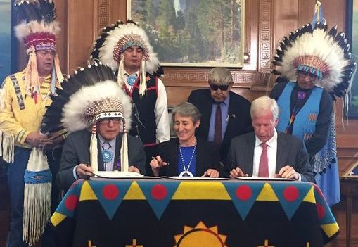 Blackfeet Nation Chairman Harry Barnes, left, Secretary of the Interior Sally Jewell and Devon Energy CEO David Hager gather
