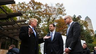 Donald Trump, president and chief executive of Trump Organization Inc. and 2016 Republican presidential candidate, left, speaks during a Bloomberg Television interview with Mark Halperin, center, and John Heilemann, co-hosts of 'With All Due Respect,' during an interview at Wollman Rink in Central Park in New York, U.S., on Monday, Nov. 2, 2015. Trump said being a businessman and fighting a war is 'all the same because it has to do with efficiency it has to do with common sense.' Photographer: Chris Goodney/Bloomberg via Getty Images