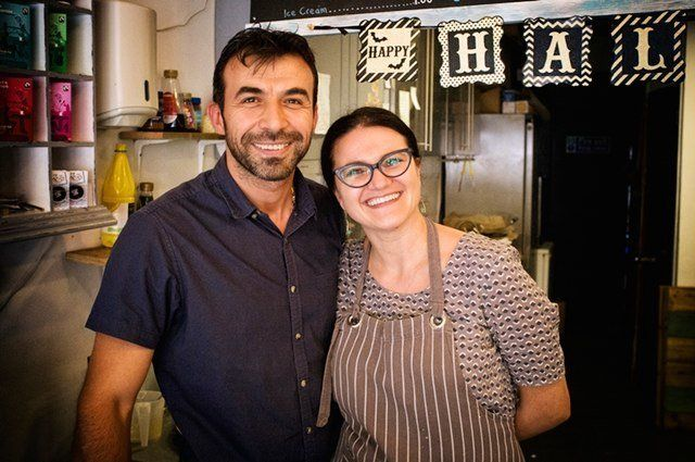 Mike, originally from Syria, is seen with his partner Carmen. His cafe, called Zig Zag, in Epsom, near London, has become the