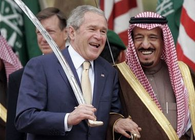 King Salman of Saudi Arabia and former President George Bush Jr. wielding the sword branded on the Saudi flag as the symbol o