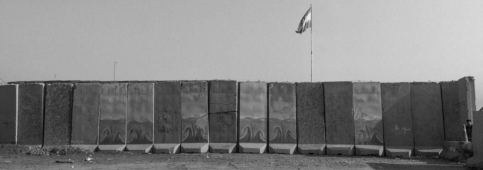 Blast walls protect a Peshmerga checkpoint on a road leading to Mosul on Nov. 7, 2016, in Bartella, Iraq.
