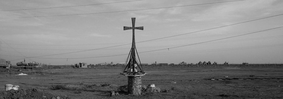 A damaged cross at the Iraqi Army Armoured Ninth Division base on Nov. 13, 2016, in Qaraqosh, Iraq.