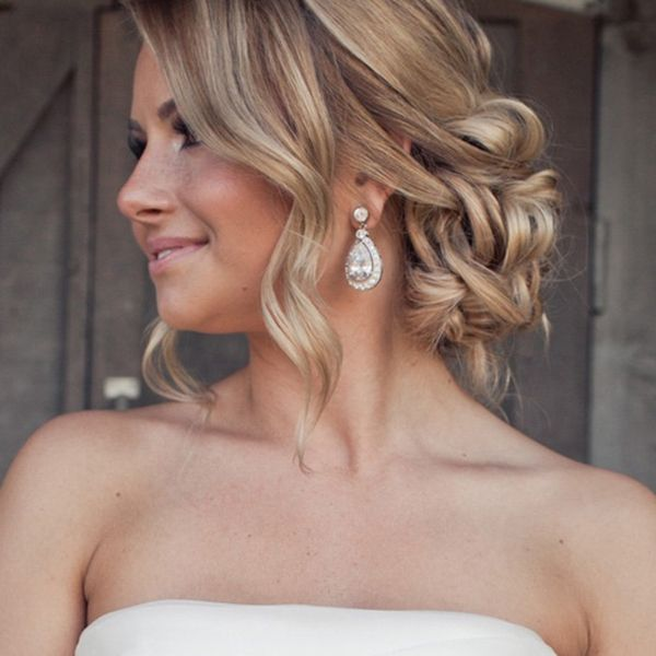 "<p><p>If you have a layered cut, leave out some curls to softly frame your face. Add sparkling chandelier earrings to complete the romantic look.</p></p> <p><p>Related: <strong><a href=""http://www.bridalguide.com/beauty-health/beauty/wedding-hair/wedding-updos#153887"" target=""_blank"">Wedding Updos That Are Beautiful From Every Angle</a></strong></p></p>"