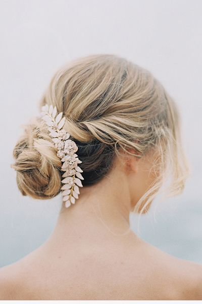 <p>A wavy, side-swept chignon is a natural choice for a boho or rustic-themed wedding. </p>