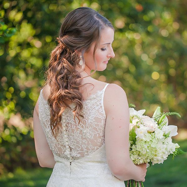 "<p>An unstructured ""faux ponytail"" with rolled sections of hair closest to your face is such a pretty option for a rustic affair.</p>"