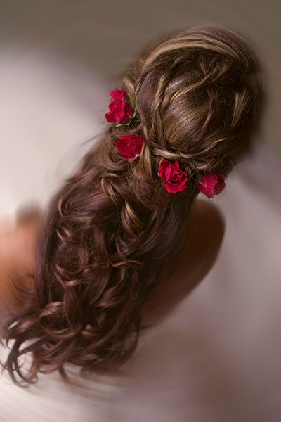 """A <a href=""""http://www.bridalguide.com/beauty-health/beauty/wedding-hair/half-up-hairstyles#154309"""" target=""""""""_blank""""""""><strong>"""