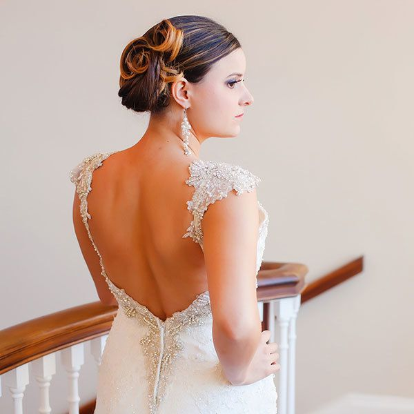<p>If you're inspired by vintage wedding details, borrow your hairstyle from a different decade, too, with pin-up curls that'll make you feel like a starlet on your big day.</p>