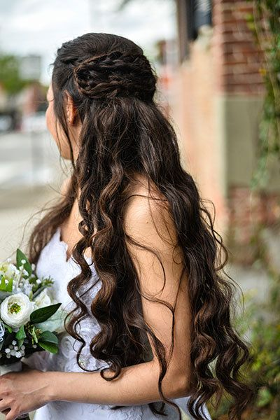 <p>Play up soft, flowing locks with a crossed Dutch braid in the back.</p>