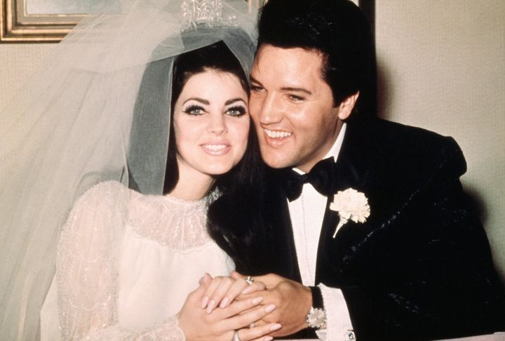 Elvis sits cheek-to-cheek with his bride Priscilla after their May 1967 wedding.