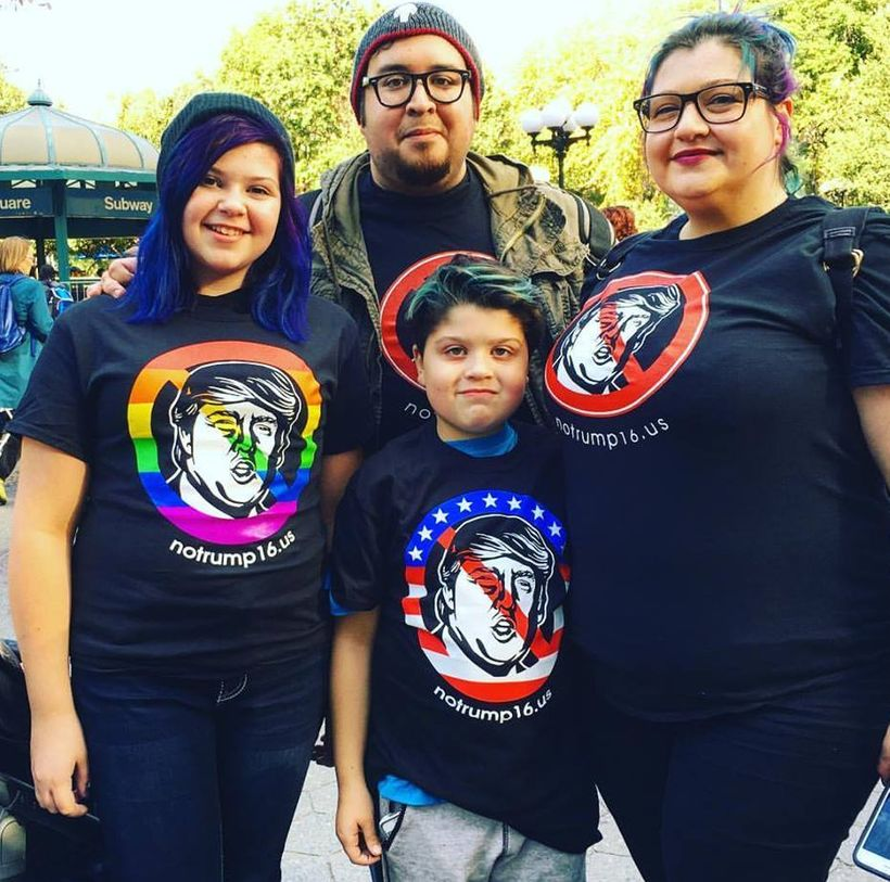 At Union Square in Lower Manhattan, a family wears original, flag, and pride versions of the NoTrump16 shirt.