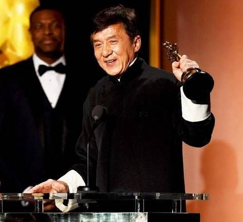 Jackie Chan receiving the Oscar award.