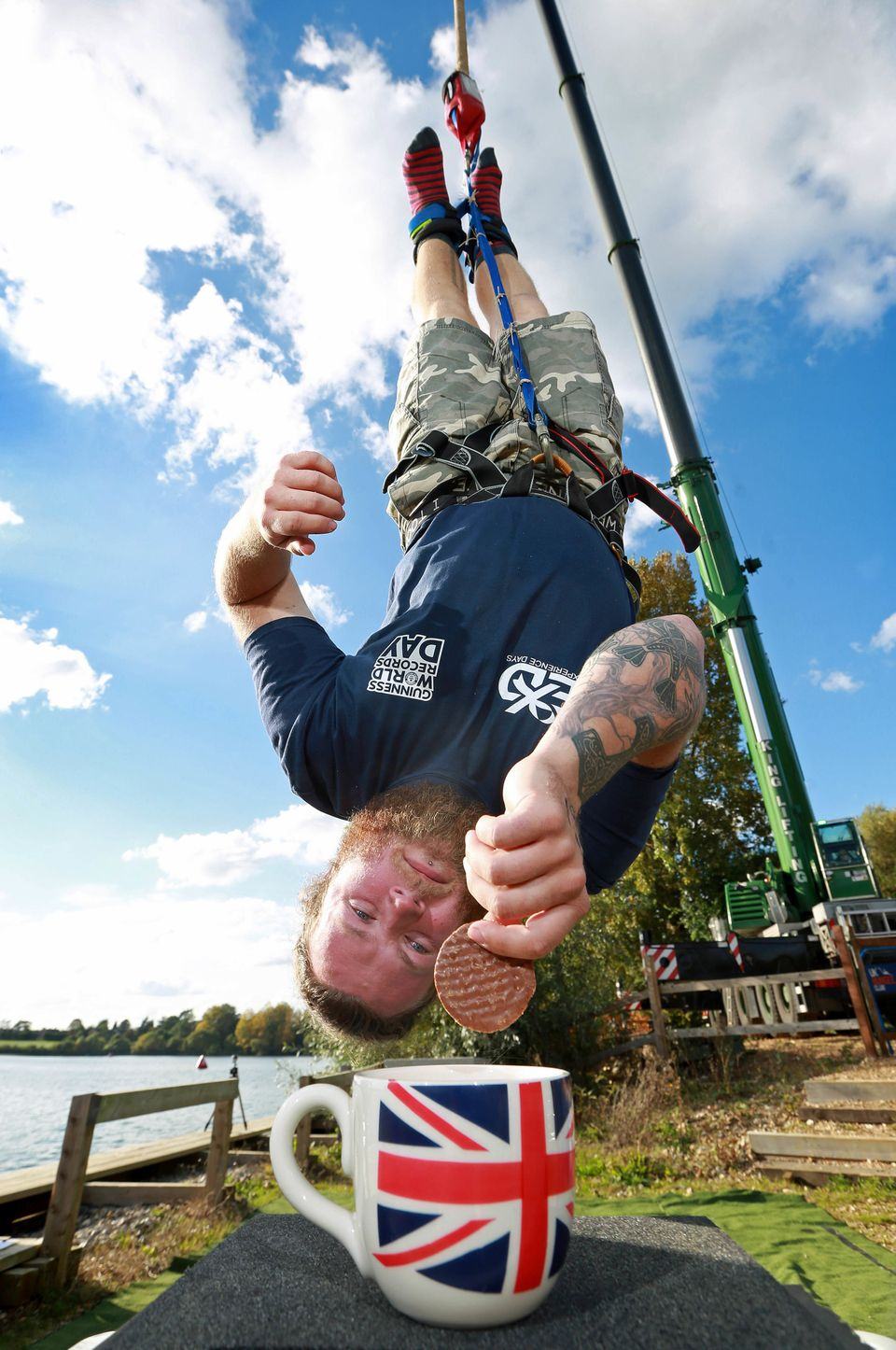 Brit Simon Berry fell 240 feet, 10 inches in order to dunk a biscuit.