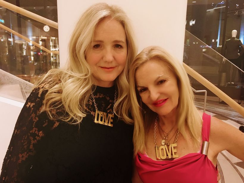 Laura Kimpton and Lita Barrie wearing LOVE necklaces at the Venetian.
