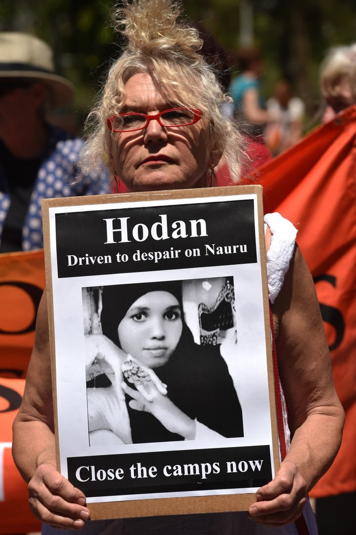 An activist in Sydney holds a placard in an event organized by Doctors for Refugees to demand humane treatment of asylum seek