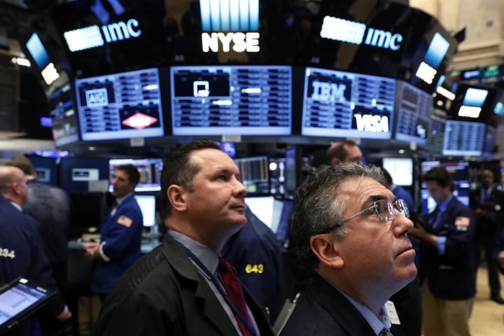 Traders work on the floor of the New York Stock Exchange (NYSE) shortly after the opening bell in New York City, NY, U.S. Nov