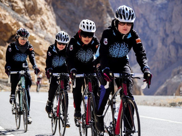 The young women on Afghanistan's national women's cycling team have to put up with harassment and even physical assault from
