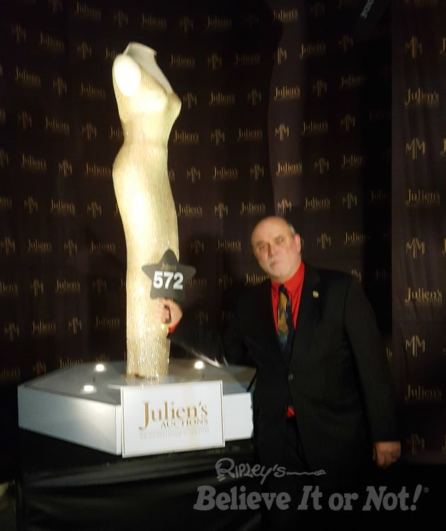 Ripley's Edward Meyer poses next to the dress Marilyn Monroe wore when she sang at President John...