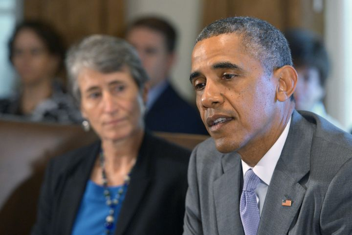 President Barack Obama sits next to Interior Secretary Sally Jewell during a 2014 cabinet meeting.
