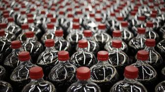 Two liter bottles of Dr. Pepper brand soda move down a conveyor belt after being filled at the Dr. Pepper Snapple Group Inc. bottling plant in Irving, Texas, U.S., on Tuesday, Oct. 25, 2016. Dr. Pepper Snapple Group Inc. is scheduled to release earnings figures on October 27. Photographer: Luke Sharrett/Bloomberg via Getty Images