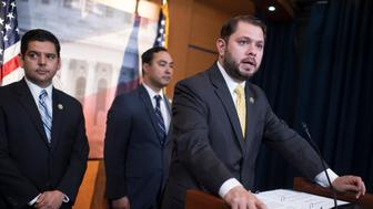 UNITED STATES - JUNE 15: Reps. Ruben Gallego, D-Ariz., right, Raul Ruiz, D-Calif., left, and Joaquin Castro, D-Texas, conduct a news conference in the Capitol Visitor Center on the Deferred Action for Childhood Arrivals (DACA) program and 'anti-immigrant' GOP amendments to the defense spending bill, June 15, 2016. (Photo By Tom Williams/CQ Roll Call)