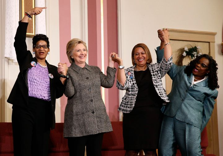 Former Democratic presidential nominee Hillary Clinton stands with (from left) Geneva Reed-Veal, Annette Holt and Rep. G