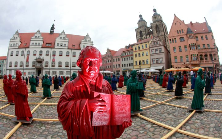 Plastic statuettes of 16th-century Protestant reformer Martin Luther, part of the art installation 'Martin Luther - I'm stand