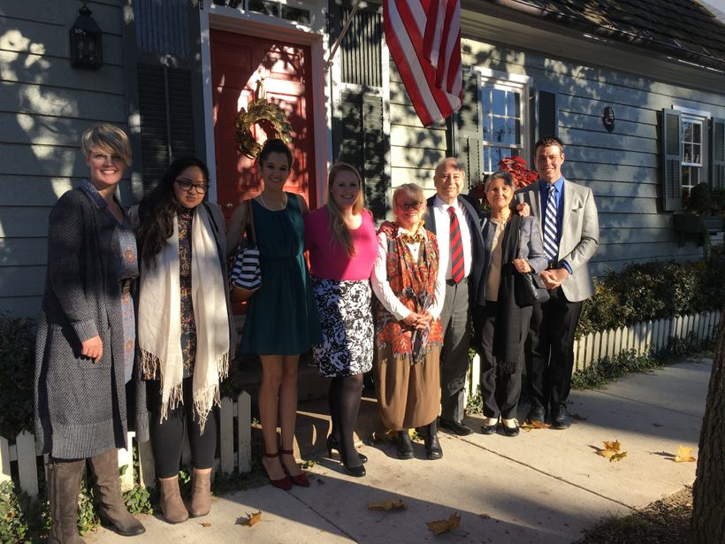 Ahmed gathers with his team, including author Patrick Burnett (far-right), and gracious hosts in front of the home of The Rev