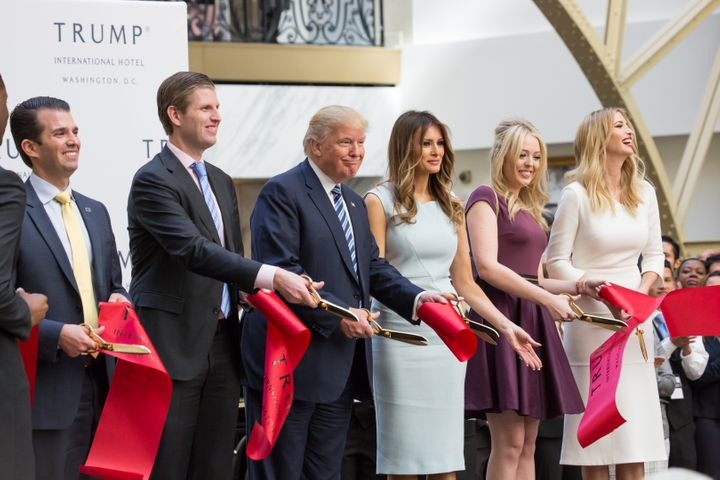 Donald Trump and his family cut the ribbon to open the Trump International Hotel in Washington. The hotel operates on a lease