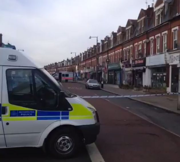 Heath Road in Twickenham is in lockdown after a man began throwing bricks at police from a