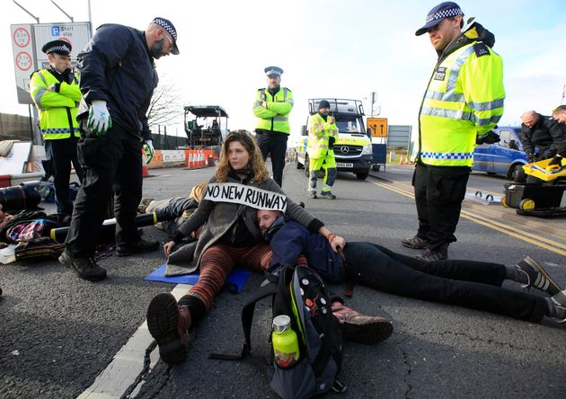 Environmental protestors block a road during a protest near Heathrow airport in west London that led...