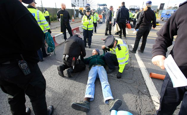 Traffic was brought to a standstill after the protesters lay on the road to protest the third