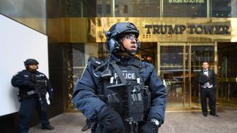 A member of the New York Police Department (NYPD)stands in front of Trump Tower on 5th Avenue to provide security to US President-elect Donald Trump on November 10, 2016 in New York. / AFP / TIMOTHY A. CLARY        (Photo credit should read TIMOTHY A. CLARY/AFP/Getty Images)