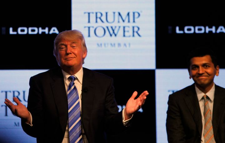 Donald Trump attends the launch of Trump Tower in Mumbai, India in 2014 with Abhishek Lodha of the Lodha Group.