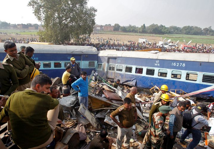 Rescue workers search for survivors at the site of a train derailment in Pukhrayan, south of Kanpur city, India November 20,
