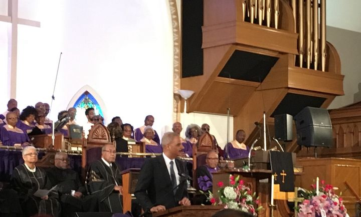 Eric Holder speaks at Gwen Ifill's funeral service in Washington on Saturday.