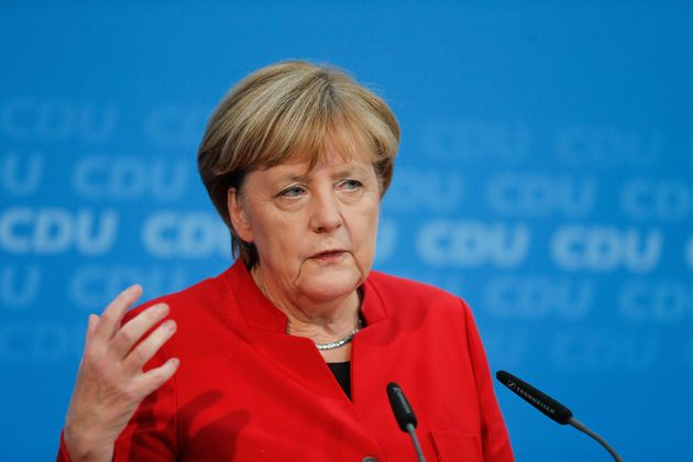 German Chancellor Angela Merkel addresses a news conference, to announce that she will run again for...