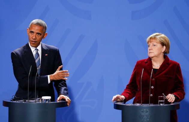 U.S. President Barack Obama speaks during a joint news conference with German Chancellor Angela Merkel...