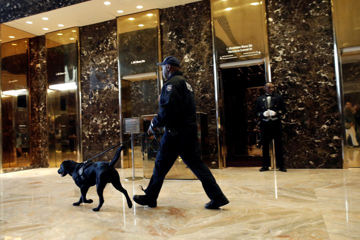 Security has been beefed up at the swanky skyscraper since Donald Trump was elected president. A police officer and K-9 are s